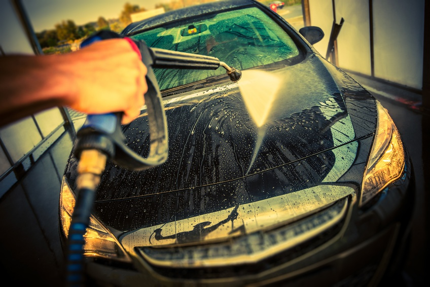 Car Cleaning in a Car Wash. High Pressure Car Washing. Taking Care of a Car.